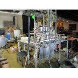 Semi-automatic 6 station bottle filler with spare parts, 112 in x 74 in ***Auctioneer Note*** -- $