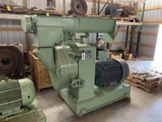 Located in Canon City CO: CPM Century pellet mill with 100hp motor screw feeder, feed chute, door, 2