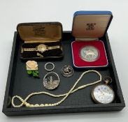 INTERESTING ITEMS LOT INCLUDING WATCHES BROOCHES COMMEMORATIVE COIN