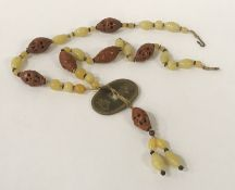CHINESE COIN & NUT NECKLACE