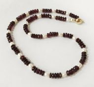 9 CT. GOLD GARNET & AKYO PEARL NECKLACE