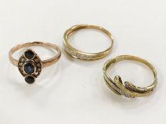 THREE 9CT GOLD DIAMOND RINGS