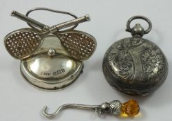 Of Tennis interest; an Edwardian silver menu holder, Birmingham 1908, with crossed racket and ball