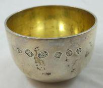A silver tumbler cup, London 2000, Millennium duty mark, of typical form, gilt interior, diameter