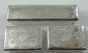 A Victorian silver set of three silver mounted glass containers, London 1860, with floral engraved