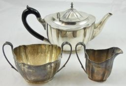 A silver three piece tea service, Sheffield 1937/38, of oval shaped form, comprising tea pot,