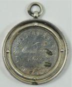 Of Welsh Eisteddfod interest; a Victorian silver presentation medal, by George Unite, Birmingham