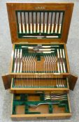 An Edwardian electroplated canteen of Old English rat tail pattern cutlery for twelve place