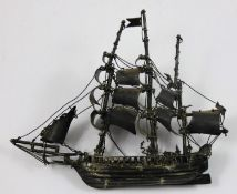 A Mexican silver model of a galleon, stamped NAVA, STERLING, MEXICO, well detailed with rigging,