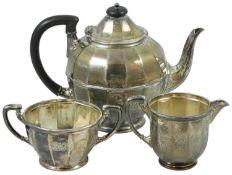 A silver three piece tea service, Sheffield 1925, of circular panelled form, comprising; tea pot,