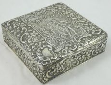 A Victorian silver box, by Nathan & Hayes, Chester 1900, the hinged cover with embossed and chased