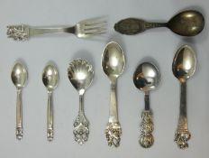 Georg Jensen, two acorn pattern tea spoons, London import 1928, a Danish silver caddy spoon, by
