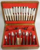 A Thomas Cork & Son stainless steel and rosewood canteen of cutlery for six place settings, mid 20th