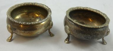 An Edwardian silver pair of cauldron salts, by Nathan & Hayes, Chester 1907 with gadrooned borders