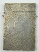 A Victorian silver card case, Birmingham 1900, with all over floral engraved decoration, 10 x 6.5