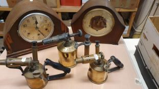 A Max Sievert, Stockholm brass blow lamp, two other lamps and two mantle clocks.