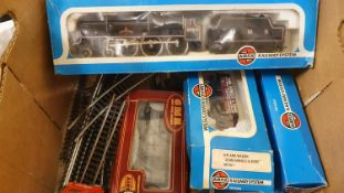 An Airfix 00 gauge Royal Scott loco, cased, various carriages and track.