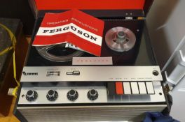 A Fergusson model 3214 four track, three speed tape recorder.