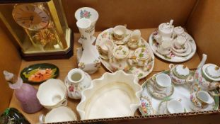 An oval Moorcroft dish, three miniature tea services, four Coalport figurines, Visiting Day, the