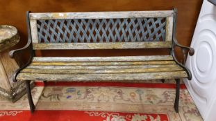 A cast alloy and wood slat garden bench.