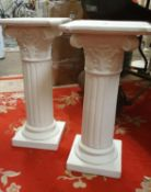 A pair of painted pottery Corinthian columns, 56 cm.