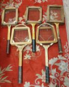 Five wood framed tennis rackets, with clamps, other wooden rackets and a collection of golf clubs