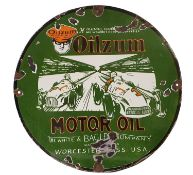 A circular vitreous enamel single sided sign, Oilzum, Motor Oil, green and orange pictorial with two