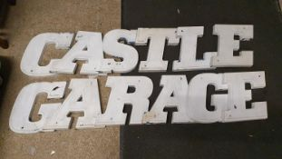 A set of plastic forecourt display letters for Castle Garage, each letter 30 cm high.