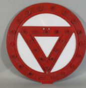 A red reflective glass mounted warning sign, diameter 61 cm.