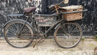 A BSA delivery bicycle, with three speed gears and rod brakes, wicker basket, sign written Scuffy