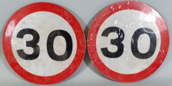 A pair of 30 MPH warning reflective signs, diameter 30 cm.