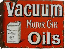 A double sided, wall mounted, vitreous enamel Vacuum Motor Car Oils sign, 41 x 51 cm.