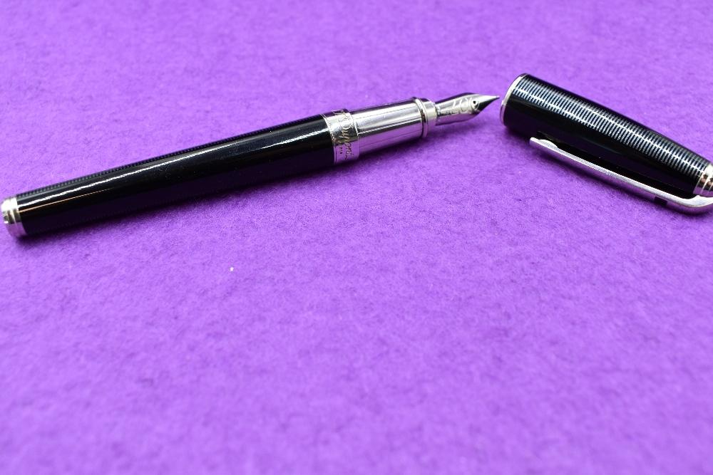 Lot 13 - A S J Dupont, Paris James Bond 007 fountain pen in black with silver trim