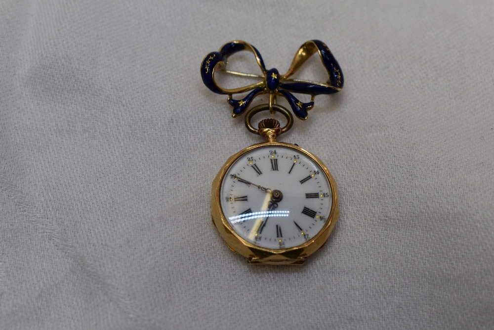 A Small Yellow Metal Top Wound Pocket Watch Stamped 18k