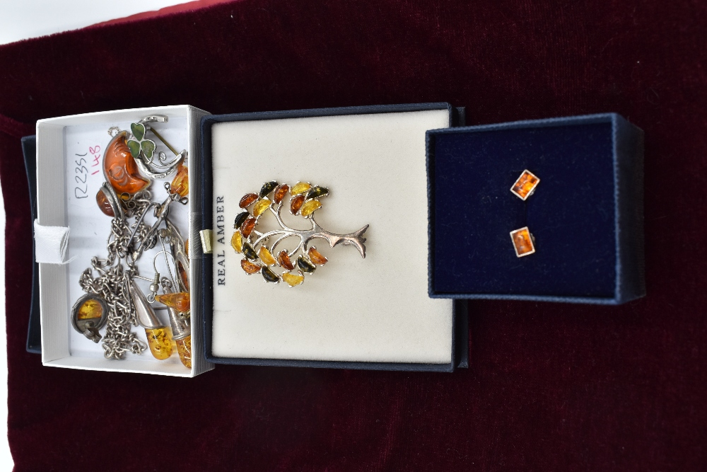 Lot 283 - A selection of white metal and Baltic amber jewellery including earrings, brooches and pendant