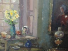An oil painting, Liam Treacy, interior with lamp, signed and attributed verso