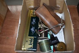 A box of assorted fishing tackle, including vintage brass fly reel and leather pocket fly case