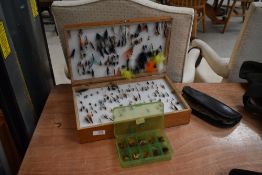 A large selection of fishing flies in double sided wooden box, wallet and small box