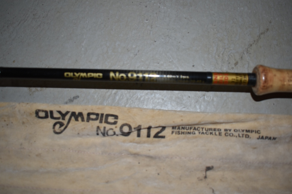 Lot 340 - An Olympic 3.6 metre 3piece Graphite fishing rod No9112 with sleeve