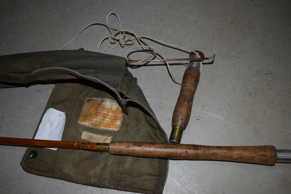Lot 343 - A 10ft split cane fly rod marked Millward Flyrover with original sleeve and spare tip