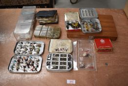 A large selection of fishing flies in boxes, tins and wallet