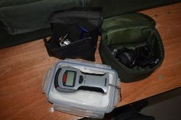 Two Daiwa spinning reels in cases and set of digital fish scales by Rapala
