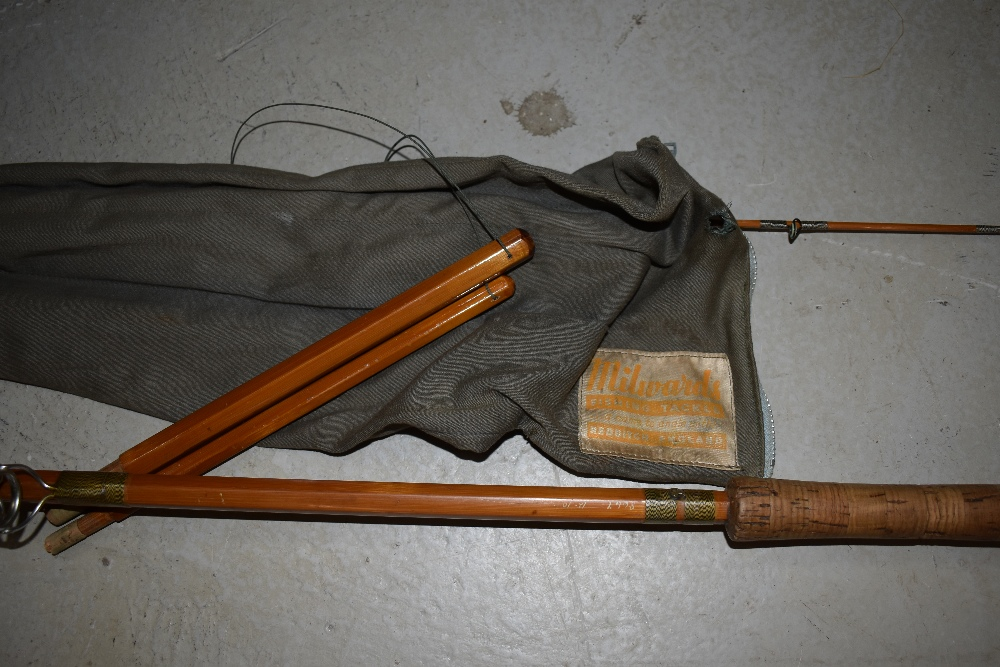 Lot 341 - A vintage Millwards fly Versa 12ft 10in split cane fly rod with spare tip in canvas sleeve