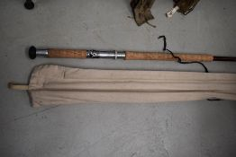 A large 14ft three peice salmon rod unmarked with sleeve