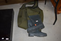 A pair of bib and brace quilted waders