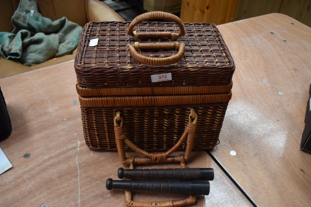Lot 372 - A basket fishing creel with two preists