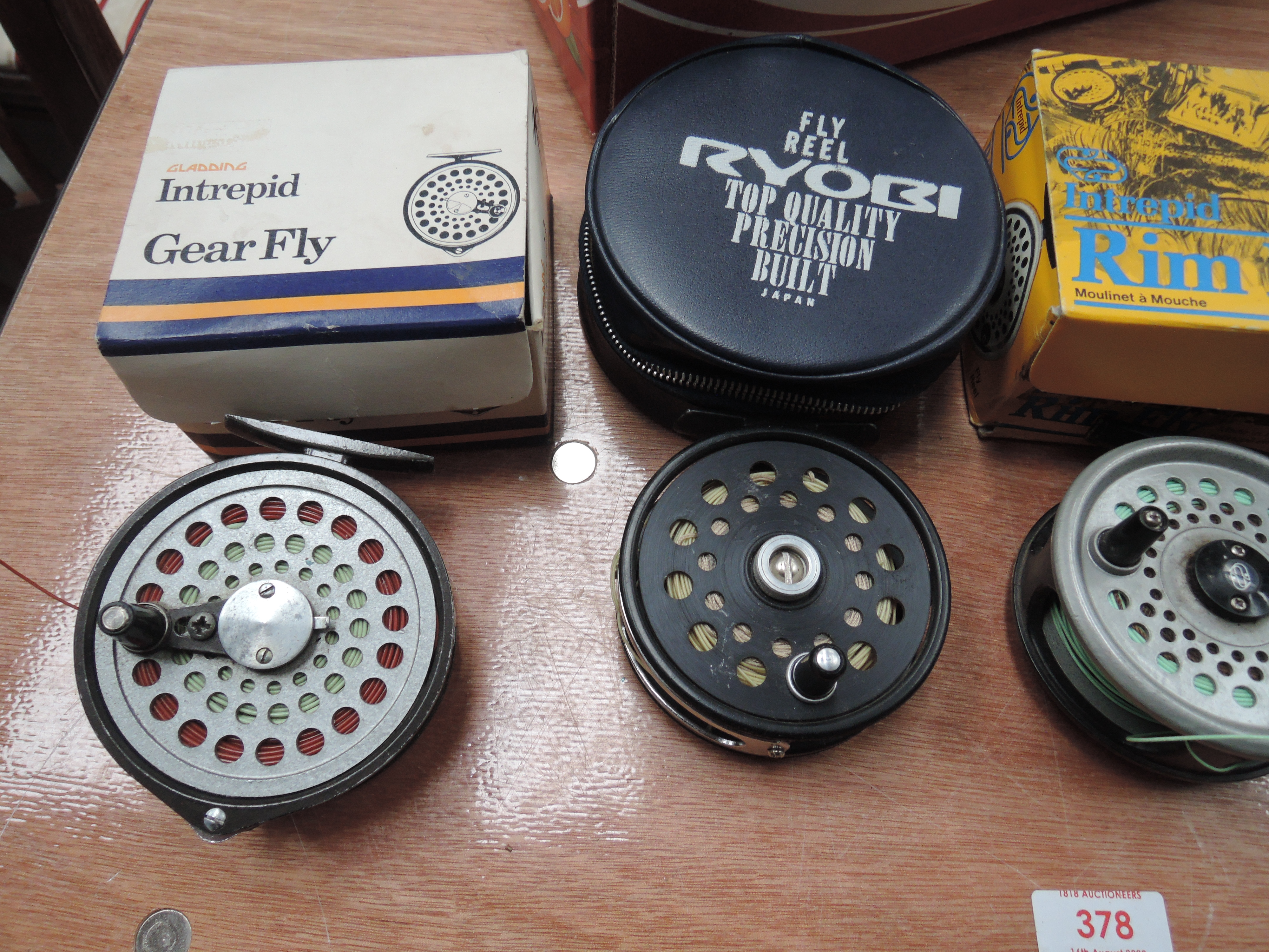Lot 378 - Four fly reels including Intrepid and Shakespeare