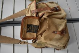 A Hardy's canvas and leather fishing bag with detachable liner