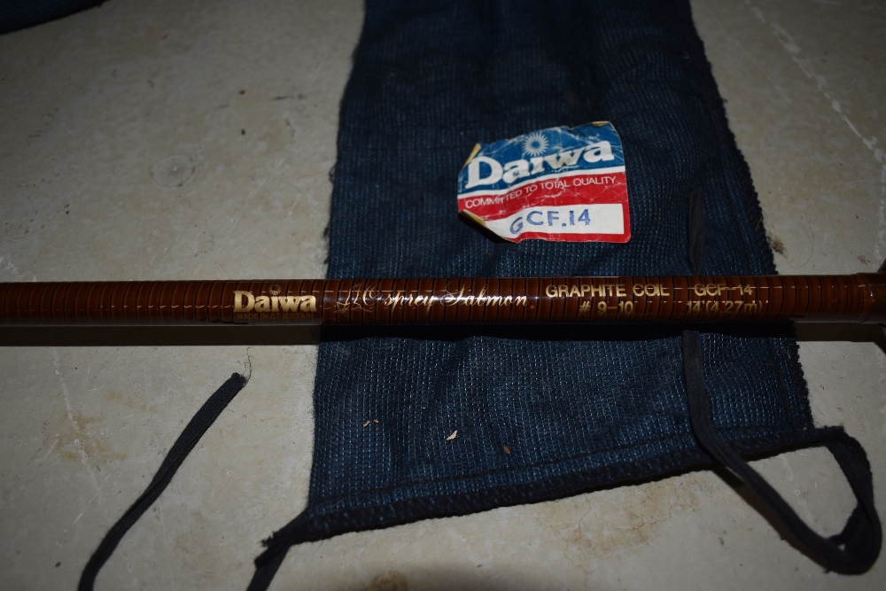 Lot 342 - A Daiwa 14ft Spey Salmon Graphite coil rod with sleeve
