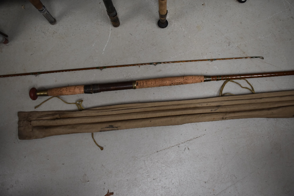 Lot 385 - A vintage 12ft cane rod with spare tip in sleeve, unmarked